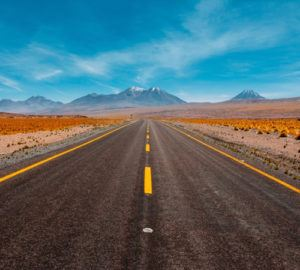 Pictured: a highway in the desert with mountains in the distance. The image suggests brands need to look beyond what is happening in the immediate future to their brand and adopt long-term perspectives on branding.