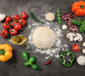 Pictured: a ball of dough and several different ingredients, including tomatoes and orange, green, and yellow peppers. Because it features choice ingredients to be added to a certain reciple, the image symbolizes ingredient branding - companies should try to make their brand be one of the key ingredients in a product or experience.
