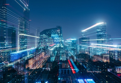 Pictured: a city landscape with fast moving lights. The image symbolizes rapid change within industries.