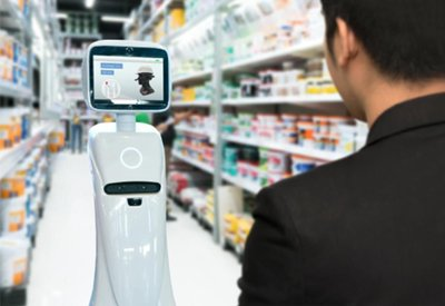 Pictured: a man is standing at a kiosk in a store aisle. The image symbolizes the benefits that deploying artificial intelligence can have for brands.