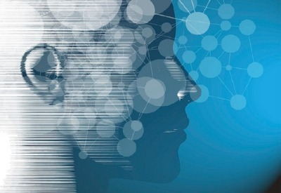Pictured: a mindmap overlaid onto of a silhouette of a human head. The image symbolizes gaining a more useful understanding of target audiences by integrating behavioral economics principles into market research.